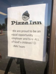 Sign in the window at Pizza Inn