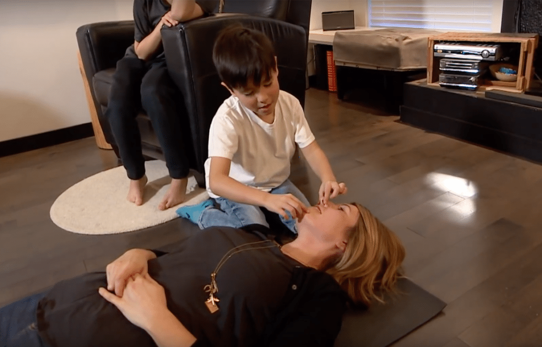 Lee Chatterson Wu teaches her sons CPR