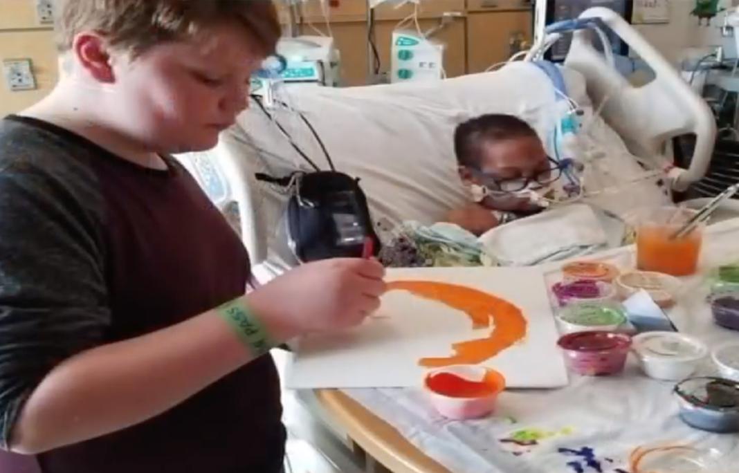 Kaleb painting with K.J.