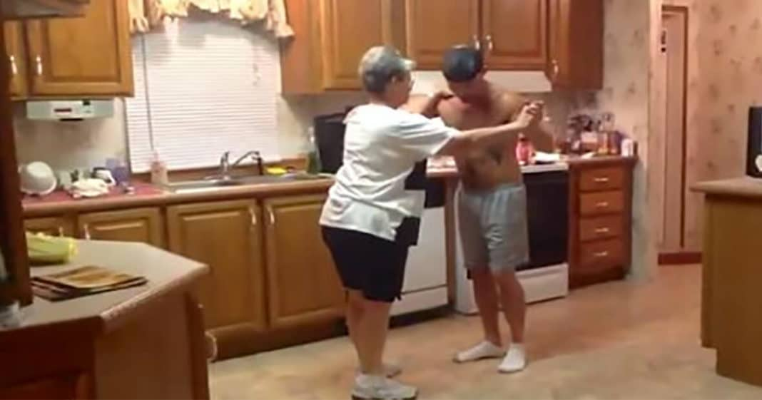Son grabs mom's hand as their favorite song comes on – now everyone's gone wild for this video