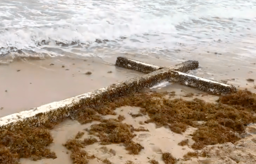 Mysterious giant cross washes up on beach after woman's prayer