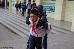 Zhang Ze gets a piggyback ride from Xu Bingyang