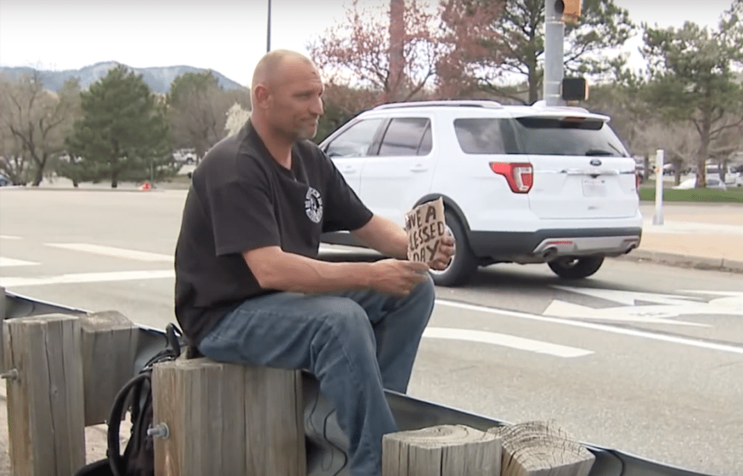 Homeless man hears fiery crash, drops his sign and starts pulling victims from cars