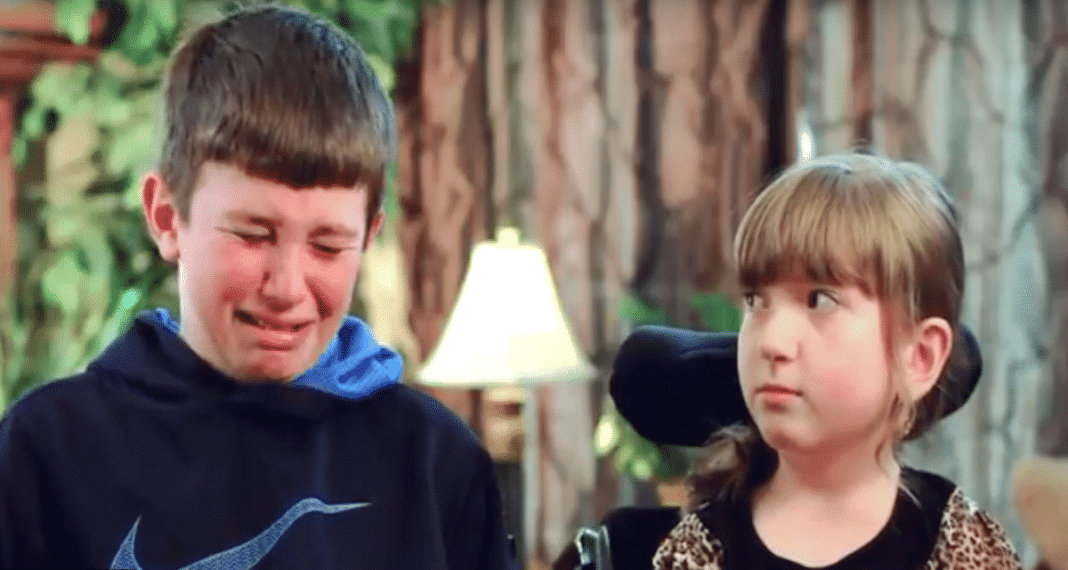 Wheelchair-bound girl is interview by tv when brother suddenly makes a tearful confession