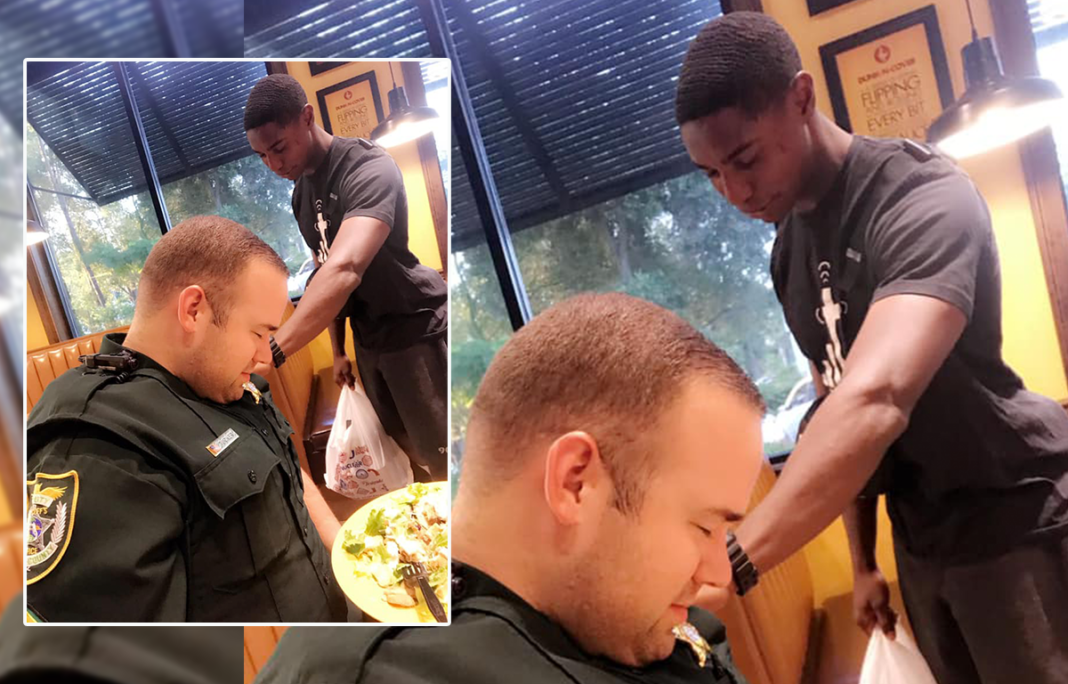 Young man moved to pray over police officer in restaurant – now he's going viral