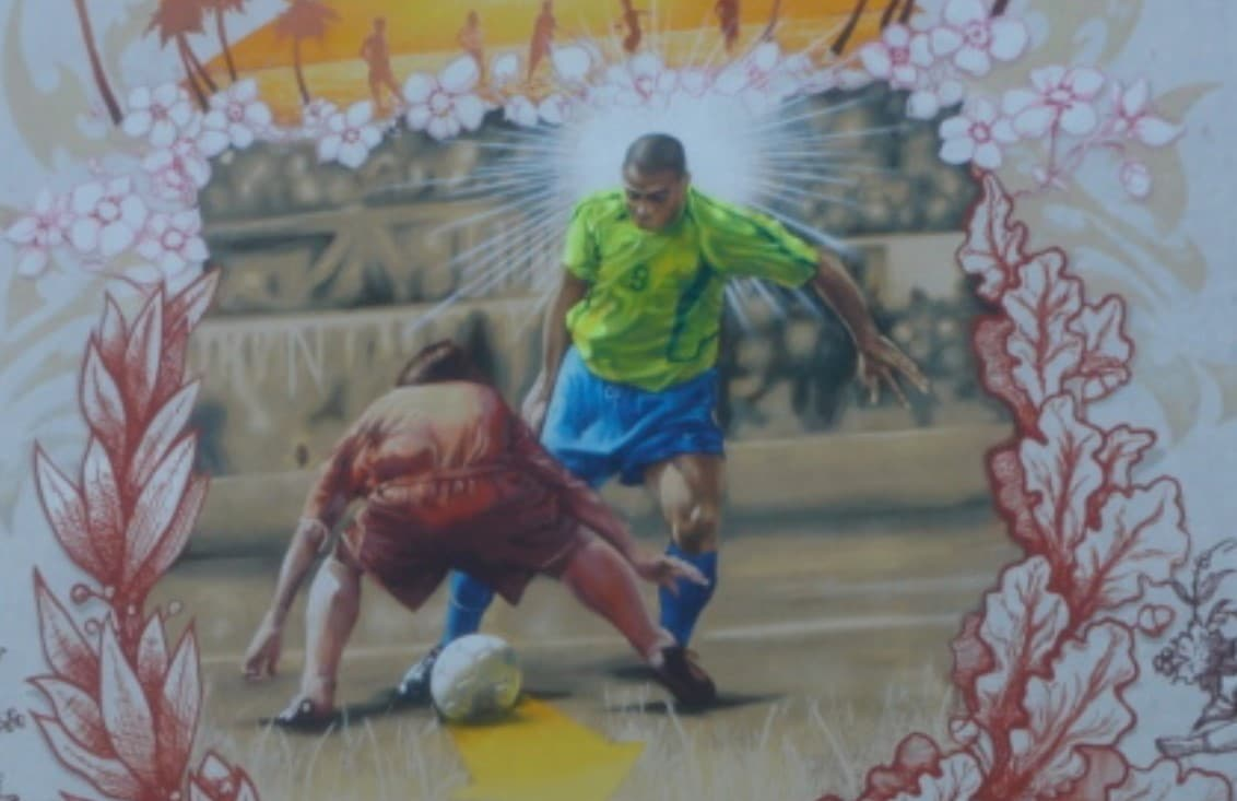 nutmegging mural showing soccer ball passing through other players legs