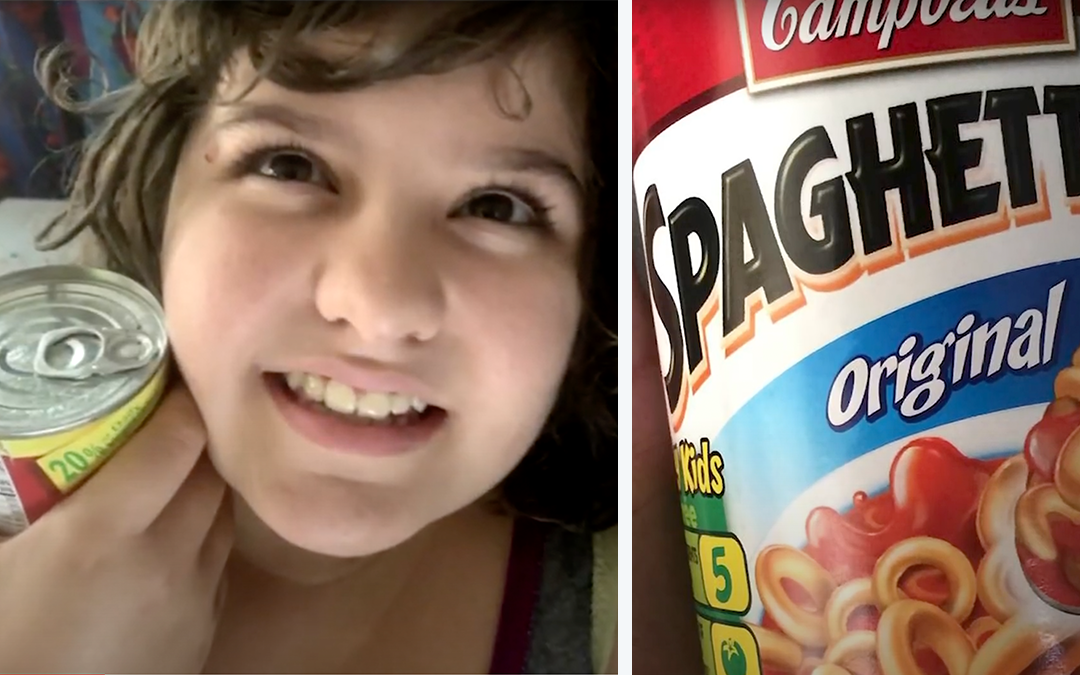 Girl holding a can of SpaghettiOs
